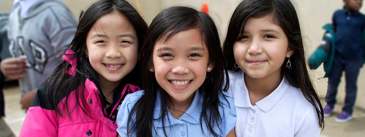 Three girls during recess at FACTS in April 2014