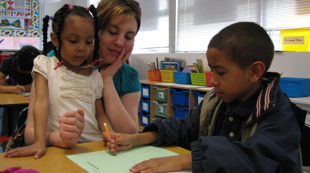 Family Reading Night at FACTS –photo of parent and kids