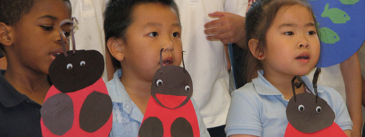 2011 FACT Spring Concert with students holding ladybugs they made